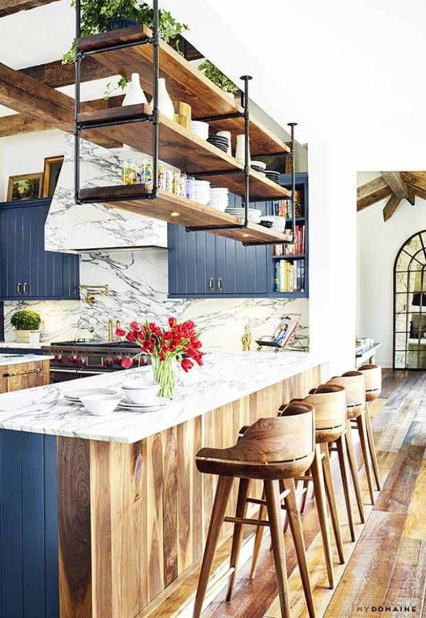 Suspended Kitchen Shelving, Marble counters, blue kitchen , wood faced, industri...