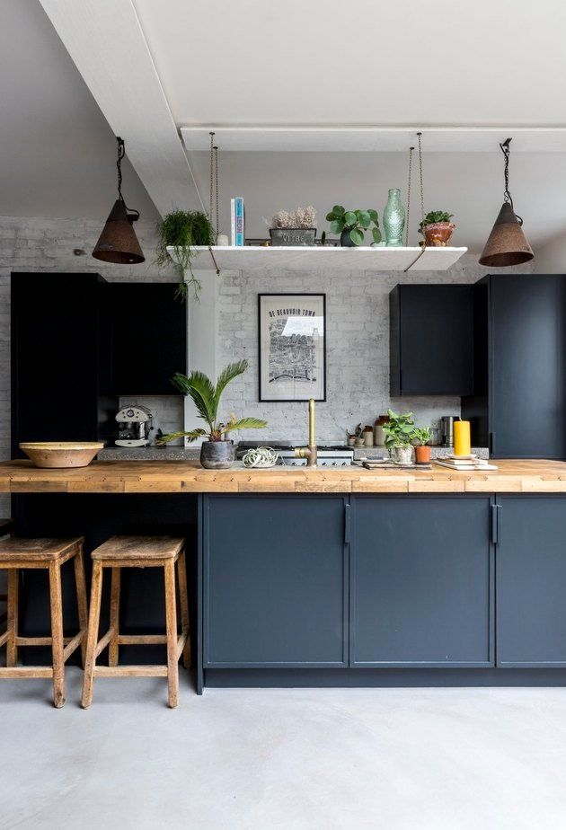 Concrete kitchen floors in modern blue kitchen