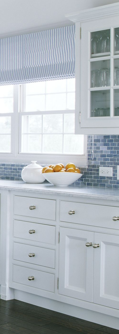 Love the crisp white cabinets with blue subway tile backsplash #blue #kitchen