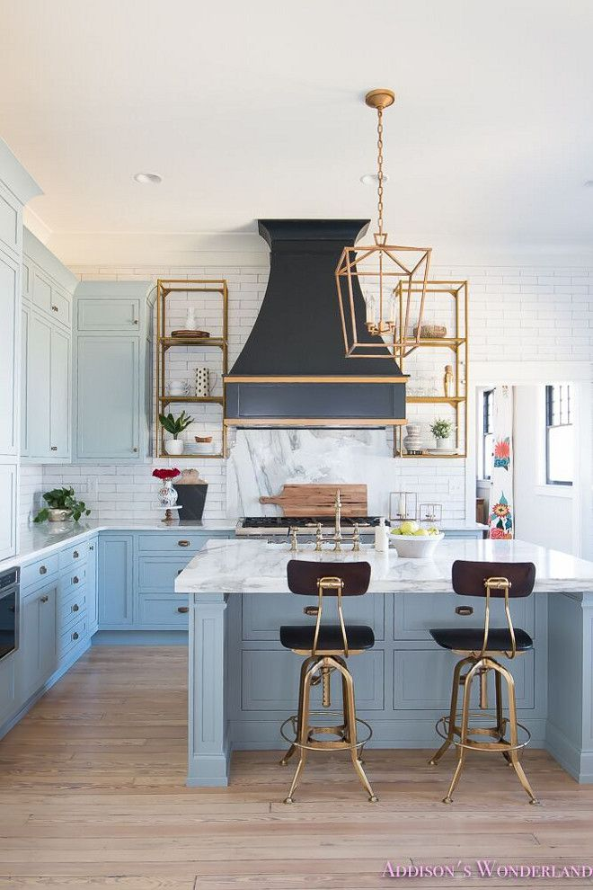 Blue Kitchen with Brass accents. A black French kitchen hood, painted in Sherwin...