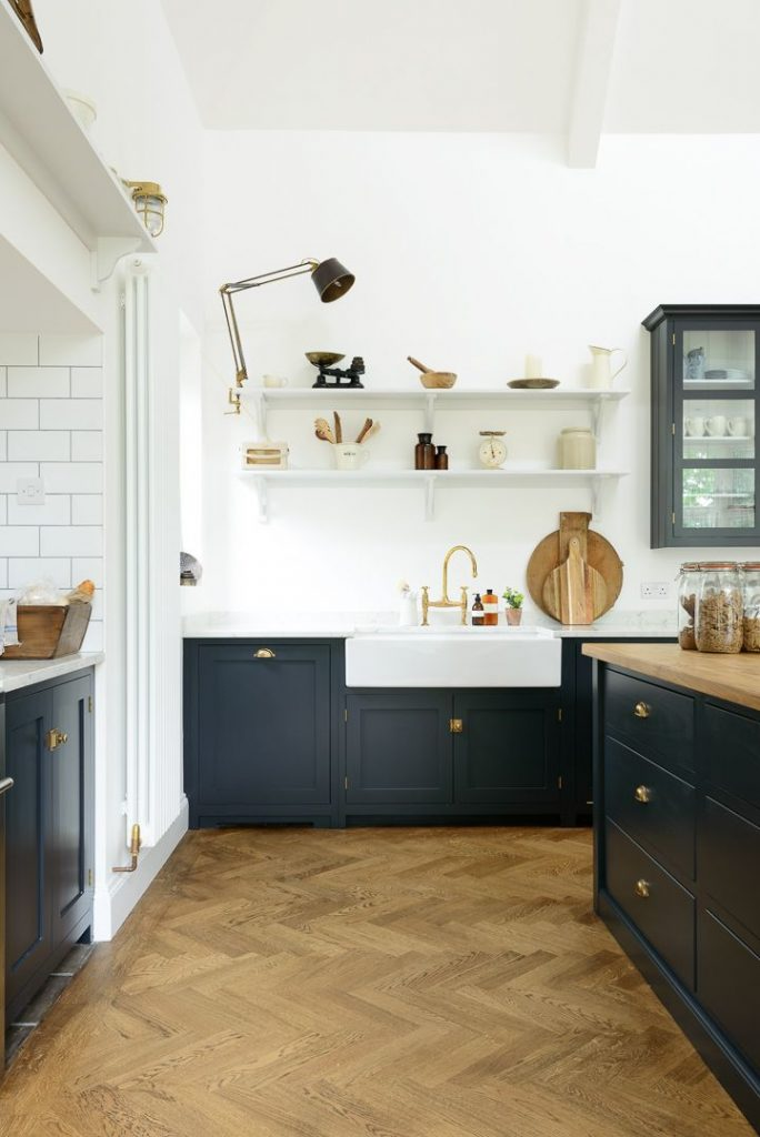 A big farmhouse sink with deVOL's Aged Brass mixer tap and simple Shaker she...
