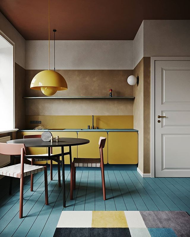 The most beautiful yellow kitchen with bare gypsum walls blue floor and pink fa ...