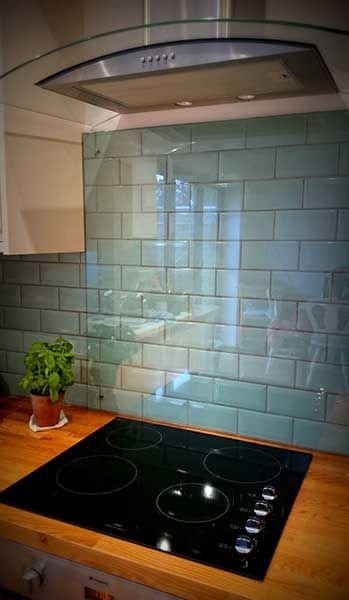 Kitchen splash back over blue duck egg tiles with hood #blue ...