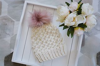 This textured knit beanie is great for beginners and advanced knitters alike, an...