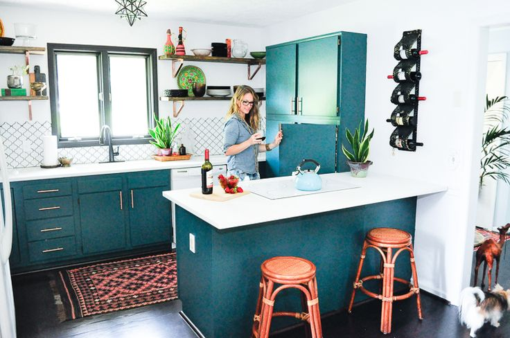 Erin Sparks in her updated kitchen with Sherwin Williams 0064 Blue Peacock Cabin...