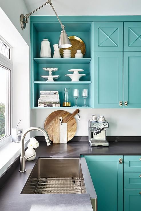 Gorgeous kitchen. Benjamin Moore's paint color: Florida Key's Blue. I love...