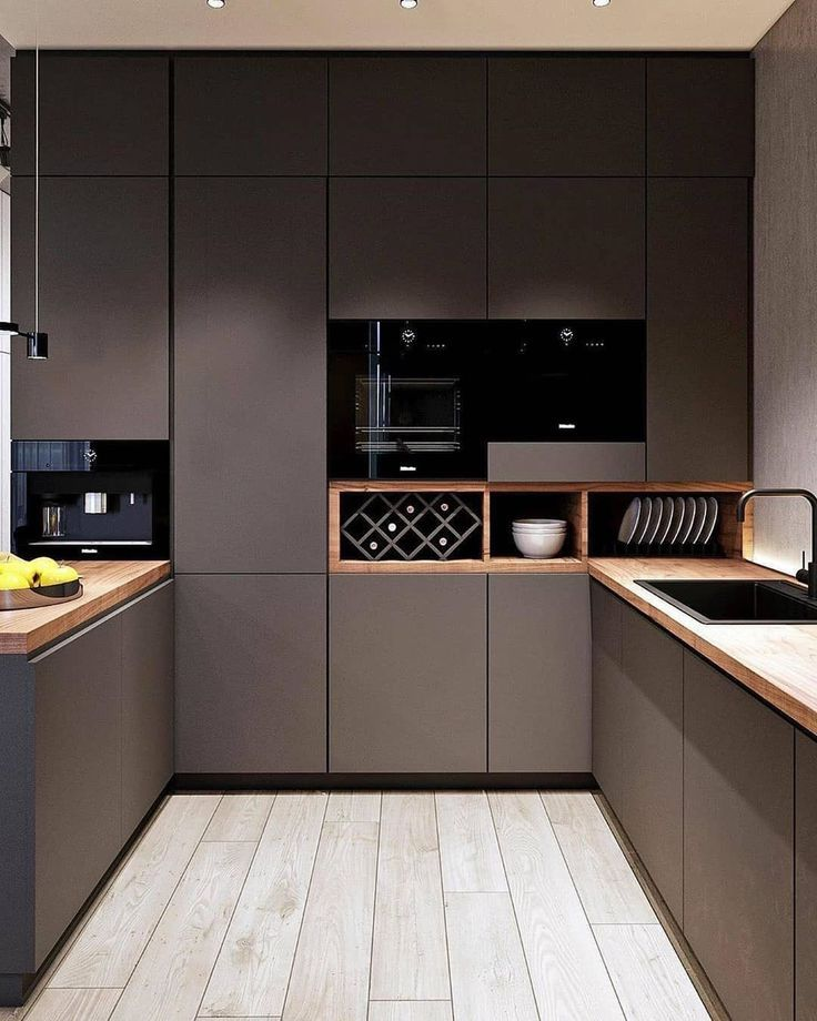 Who would feel comfortable in such a dark kitchen? ...