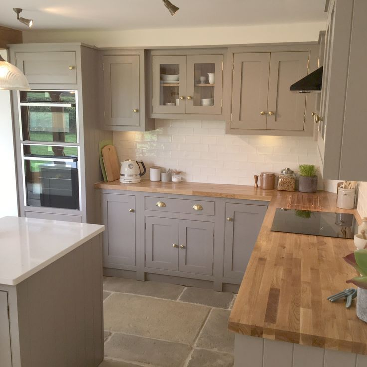 Grey, country cottage kitchen with island and wooden worktops - Decor