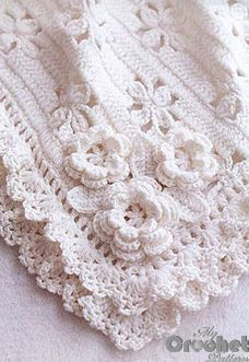 White crochet blanket with flowers pattern for babies