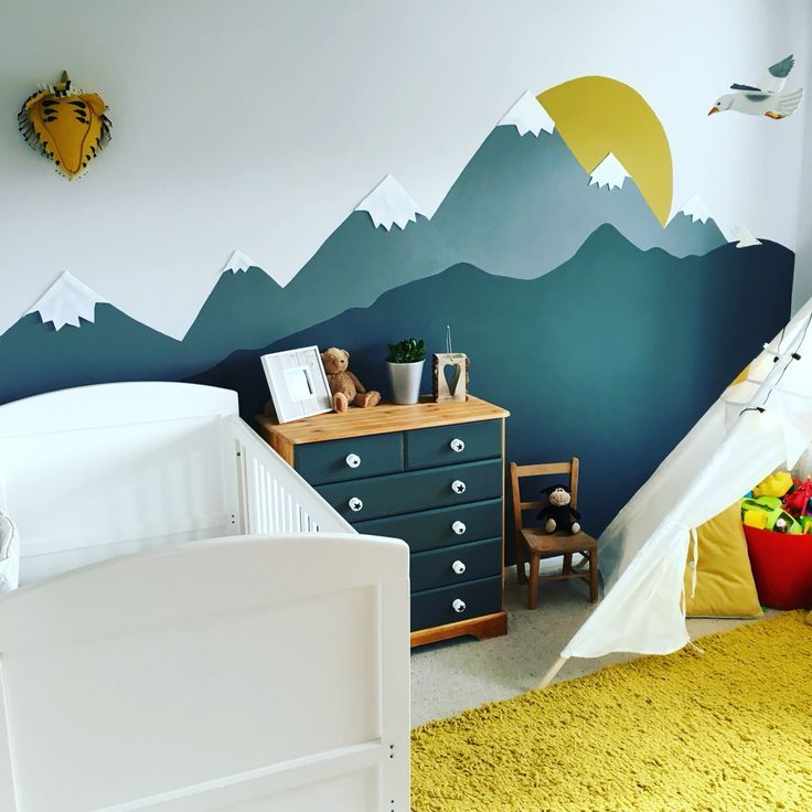 Mountain mural kids room in mustard yellow and gray. Dark gray is Farrow and Ball Downpipe gray. Yellow is habitat. Carpet from BQ. Teepee from Hobbycraft. Hand-printed walls and renovated drawers.
