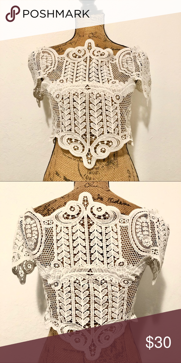 White Crochet Style Top Very cute and stylish white crochet style top. Has no st...