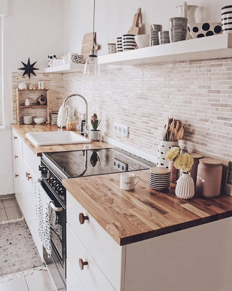 A white or black stove top cover in this quaint kitchen would add more countersp...