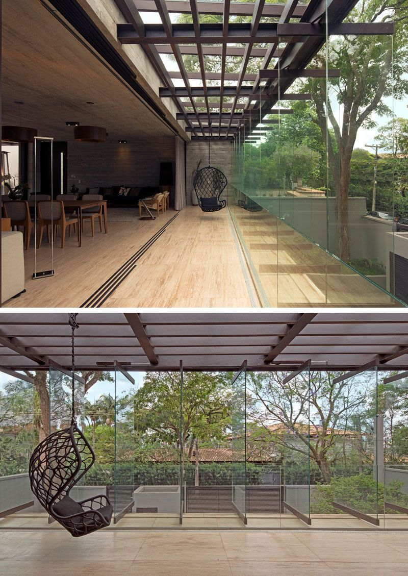 A large retractable wall connects the interior to a semi-outdoor space, that has...